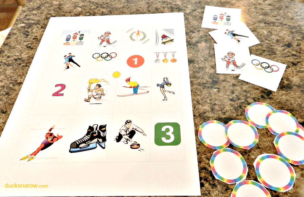 """O is for Olympics preschool """"bingo"""" game by Ducks 'n a Row. Includes game board, bingo buttons and calling cards with instructions."""